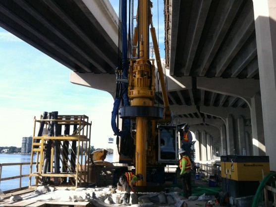 Installing drilled shafts between two bridges